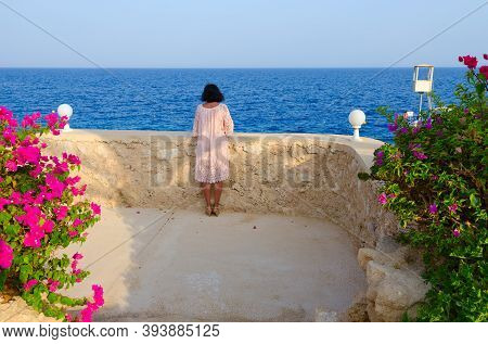Sharm El Sheikh, Egypt - September 16, 2020: Unknown Girl Admires Beautiful View At Stella Di Mare S