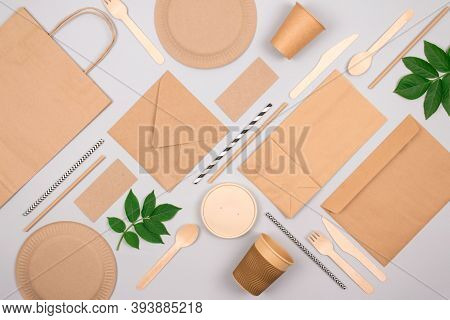 Flat Lay Composition With Eco-friendly Tableware - Kraft Paper Food Packaging On Light Grey Backgrou