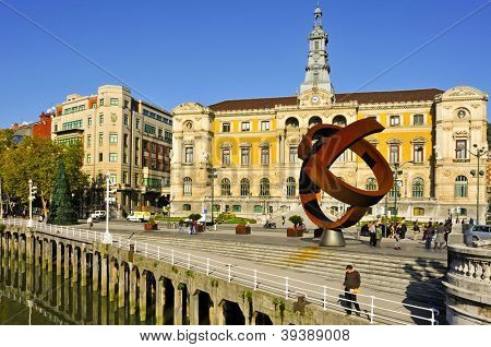 BILBAO, SPAIN - NOVEMBER 14: Town Hall and sculpture Variante Ovoide de la Desocupacion de la Esfera on November 14, 2012 in Bilbao, Spain. The sculpture was designed by Jorge Oteiza