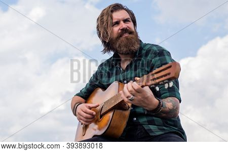 Pop Music. Musical String Instrument. Mature Charismatic Male Guitarist. Guy With Beard And Moustach