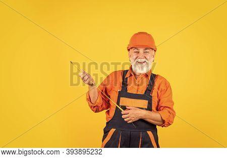 Mechanic At Work. Measurement. Engineer Size Measuring. Construction Man Measuring Tape. Engineering
