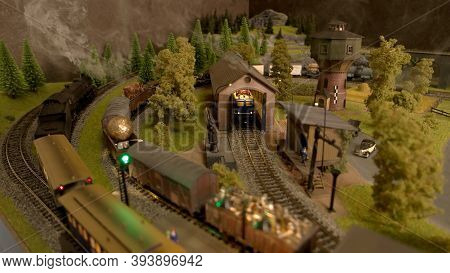 Toy Cargo Trains In The Depot. Countryside Railway Station.