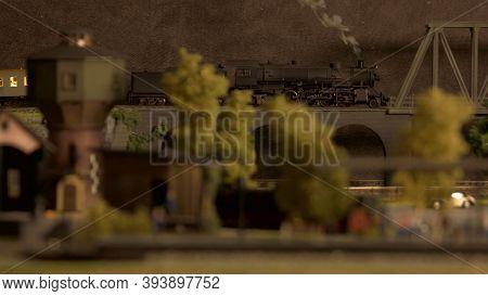 Model Of Lokomotive Train On The Bridge. Miniature Toy Plastic Railway Station.