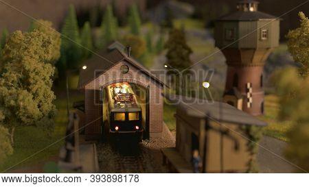 Model Of Retro Train Shed. Miniature Toy Lokomotive In A Depot.