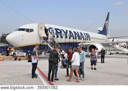 Krakow, Poland - August 28, 2018: Passengers Disembark Boeing 737 Of Low Cost Airline Ryanair At Kra