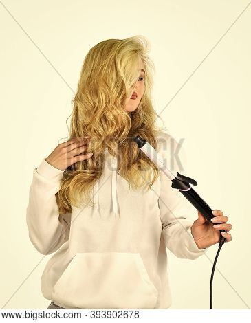 Is It Me You Are Looking For Girl Care About Her Hairstyle. Woman Curling Hair With Straightener. Wo