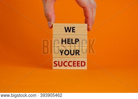 Male Hand Placing A Block With Word 'we' On A Blocks Tower With Words 'we Help Your Succeed'. Beauti