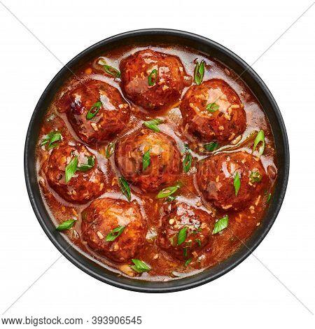 Veg Manchurian Gravy Balls In Black Bowl Isolated On White. Vegetarian Manchurian Is Indian Chinese