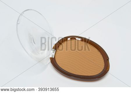 Pressed Powder Used For Makeup, That Gives Coverage To The Face, Concealing Blemishes And Discolorat