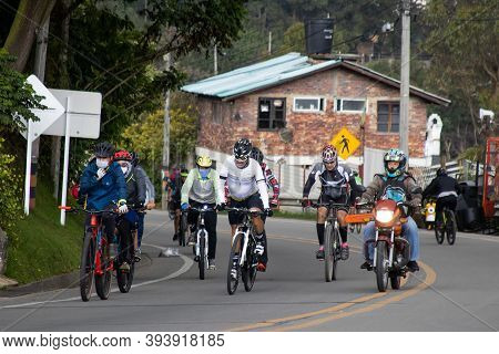La Calera Colombia - October, 2020: Group Of Amateur Cyclists Arriving To The Well Known Alto De Pat