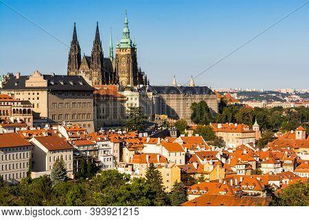 Prague, Czech Republic - September 19, 2020. Panorama Of Prague Castle And Orange Roofs Around