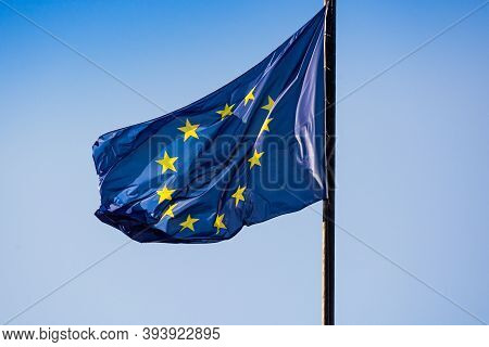 Prague, Czech Republic - September 19, 2020. Flag Of European Union Flying In The Wind On The Blue S
