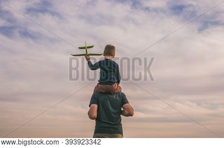 Happy Child Playing Outdoors. Boy Play Airplane.  Little Kid Dreams Of Being A Pilot. Father And Son