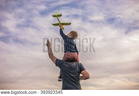 Father And Son Playing Outside With Plane Toy.  Childhood Memories. Father And Son Playing Outside.