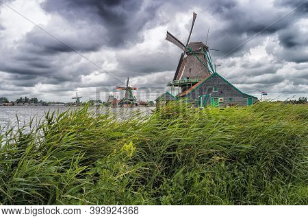 A Dutch Mill In The West Of The Netherlands. The Photo Is Make In The Zaanse Schans In The West Of T