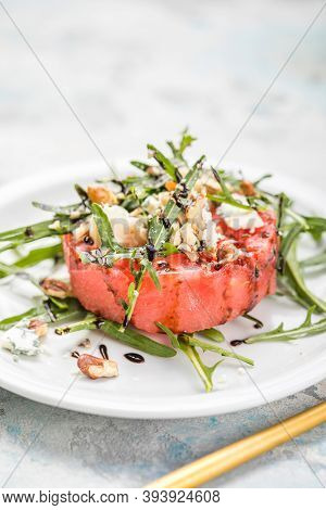 Watermelon Salad. Summer Watermelon Salad With Blue Cheese , Arugula On Light Background. Healthy Fo