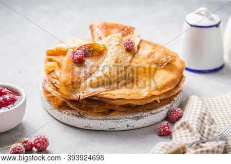 Homemade Recipe Of Thin Crepes (blini) For Breakfast Or Dessert Crepes With Berry In A Cast Iron Pan