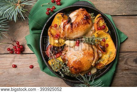 Roasted Christmas Chicken  Thighs With Pumpkin   For Christmas Dinner. Festive Decorated Wooden Tabl