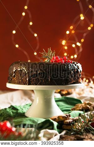 Homemade Christmas Chocolate Cake In Form Of Xmas Traditional Symbols - Candy Cane, Gingerbread Man,