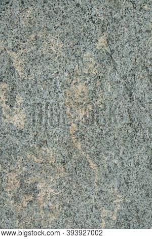 Natural Stone Grey Granite Background. Bright Hard Grey Granite Rock Texture. Grey Granite Stone Bac