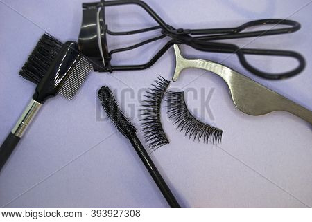 Fake Eyelashes & Accessories. Composition With False Eyelashes On Table.  Flat Composition With Fals