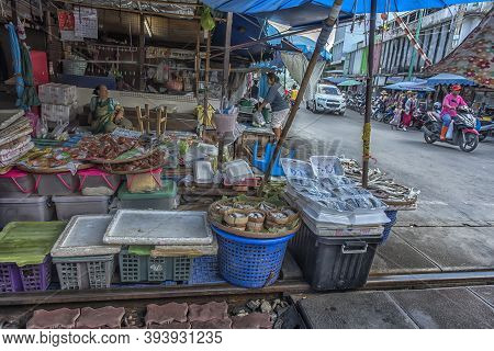 Maeklong Railway  Market Is A Traditional Thai Market Selling Fresh Vegetables, Food And Fruit.what