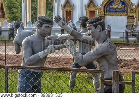 Statues Of Fighters Of The Ancient Thai Martial Art Muay Boran In The Temple Of Bang Kung Camp