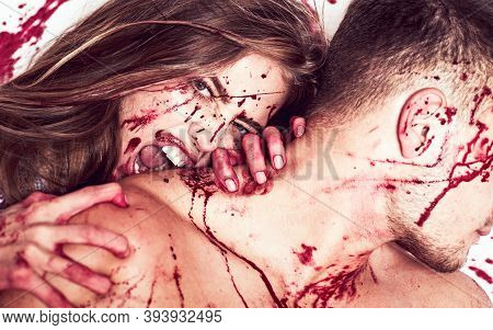 A Bloody Couple, A Vampire Girl Bites A Muscular Man By The Neck. A Terrible Halloween Episode, The