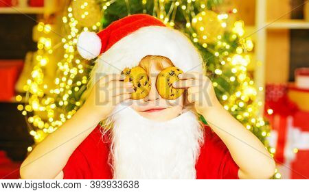 Santa - Funny Child Picking Cookie. Santa Boy Child Eating Cookies And Drinking Milk. Santa Claus Ho