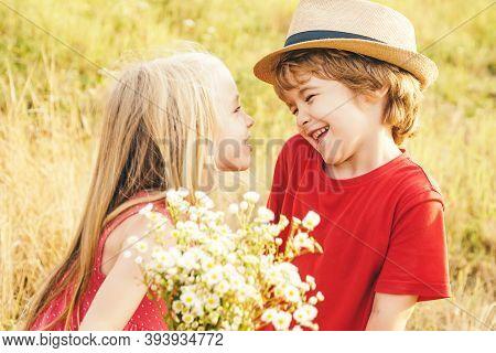 Kids Having Fun In Field Against Nature Background. Valentine. Sweet Angel Children. Valentines Day