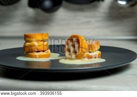Soft Waffles Soaked In Condensed Milk With Lie On Gray Plates In The Kitchen