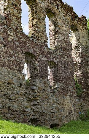 Scenic Ruins Of The Buchach Medieval Castle . Ruined Wall With Empty Window Opening Close-up . Bucha