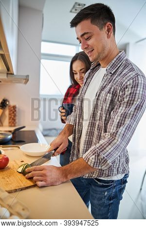 Pleased Male Spouse Cooking For His Wife