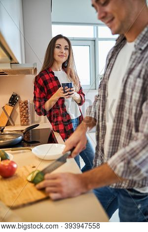 Wife Admiring Her Spouse Cooking For Her