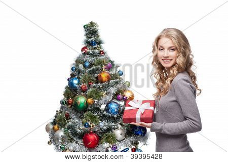 young smiling woman holding christmas gift