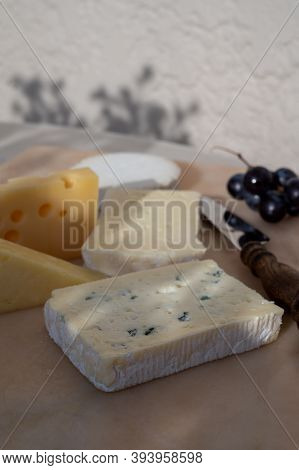 French Cheese Collection On Marble Board, Emmental, Carre De Aurillac, Petit Cantal Aop Jeune, Buche