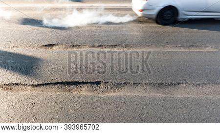 Rut On Asphalt Road In The City. Road Requiring Repair, Example Of Corruption In The Repair Of Roads