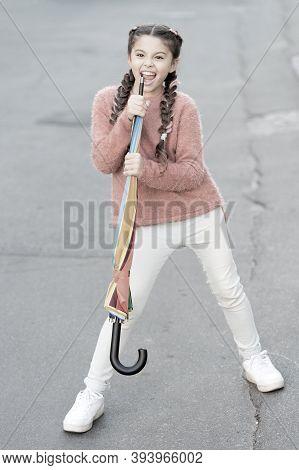Girl Child Long Hair Ready Meet Fall Weather With Folded Umbrella. Fall Season. Colorful Fall Access