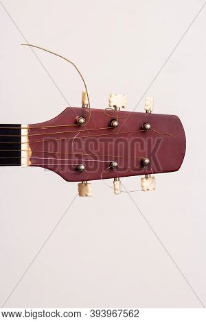 Guitar Headstock On A White Background. Close Plan. Wooden Guitar.
