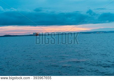 Blue Sky With Image Of The Ocean And The City. Morning Seascape With The City, Blue Sky And Clouds B