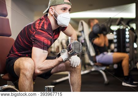 Young Men Working Out Wearing Face Mask & Latex Rubber Gloves,performing Bicep Curl With Dumbbells,c
