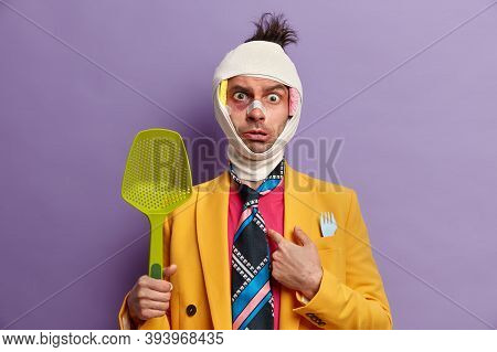 Photo Of Puzzled Man Asks Why Me, Points At Himself, Applies Bandage On Injured Head, Has Bruising A