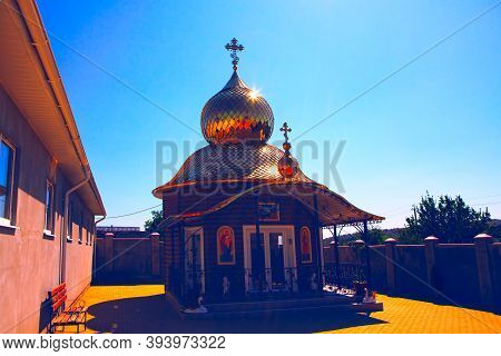 Steeple In The Church Yard . Monastery With Golden Dome In Russian Style