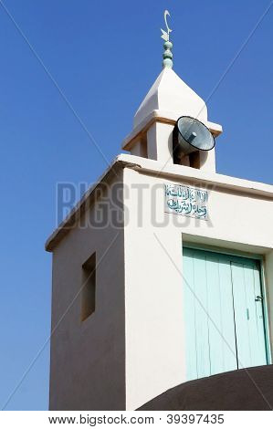White minaret with megaphone in the medina of Sousse in Tunisia poster