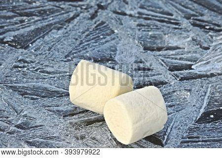Mouth Watering Marshmallow On The Patterned Cold Ice. Marshmallow  Cream Colored
