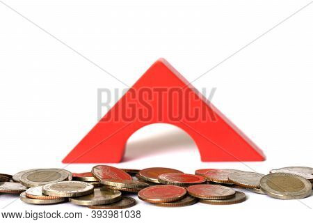 Concepts Of Saving And Investing With Real Estate. Many Silver Coins Were Placed In Front Of Red Woo