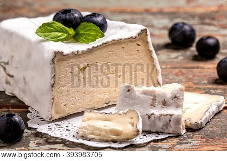 Craft Cheese From Cows And Goats Milk. Soft French Cheese With Ash, Goat Cheeses, Home Made Cheese F