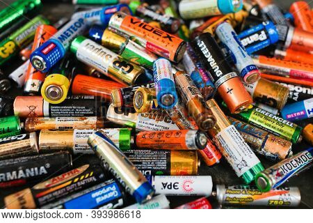 Krasnodar, Russia - 8 June, 2019 Batteries Background. Old Used Discarded Aa Cells And Other Electri