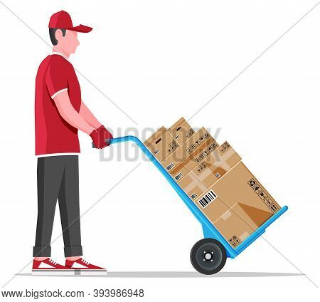 Courier With Barrow Full Of Boxes Isolated On White. Metallic Two Wheeled Trolley With Cardboard Box
