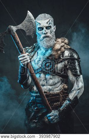 Armed With Huge Two Handed Axe And Dressed In Dark Armour With Fur Northern Undead Warrior Staring A